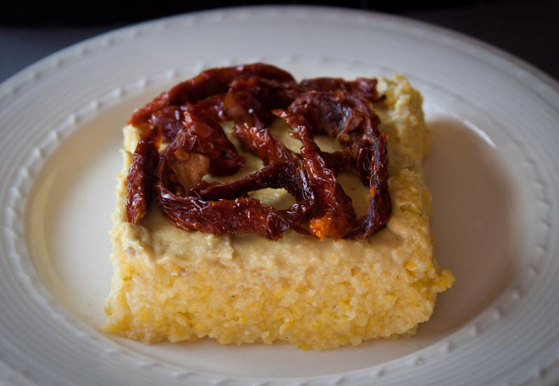 cheezy polenta with sundried tomatoes